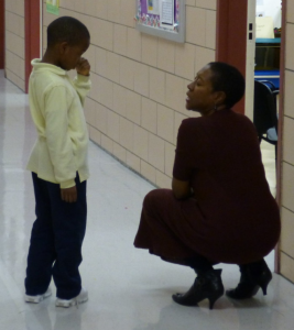 Teacher helping her student
