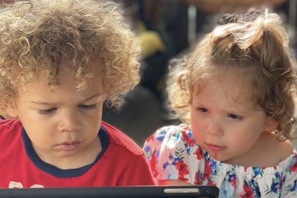 Two Children looking at a computer screen